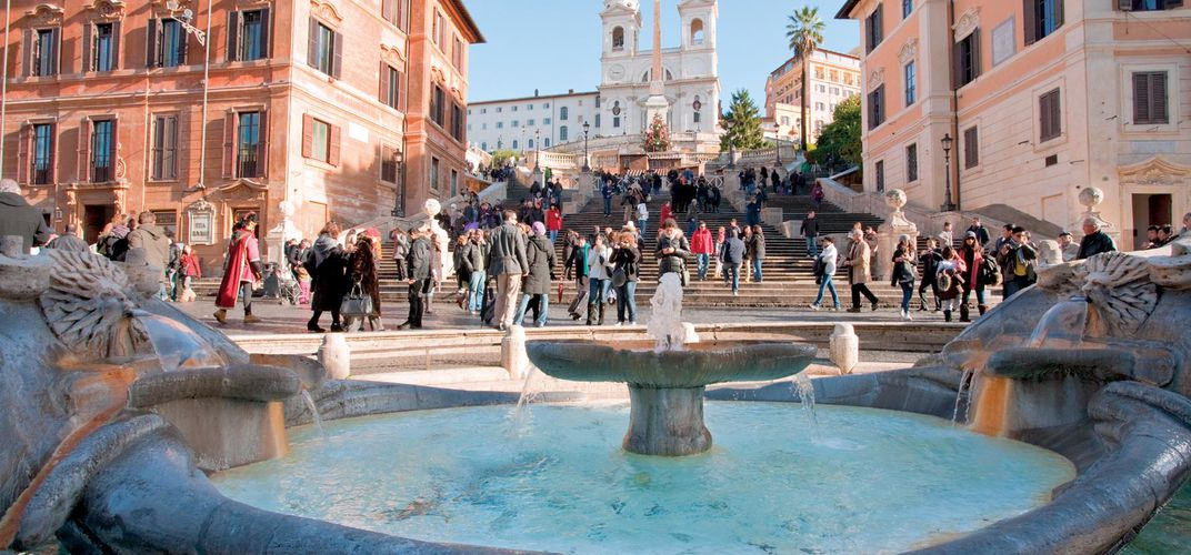 Fountain at Piazza di Spagna with Spanish Steps in background