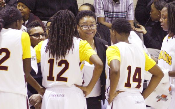 Coach motivates her girls, both on and off the court