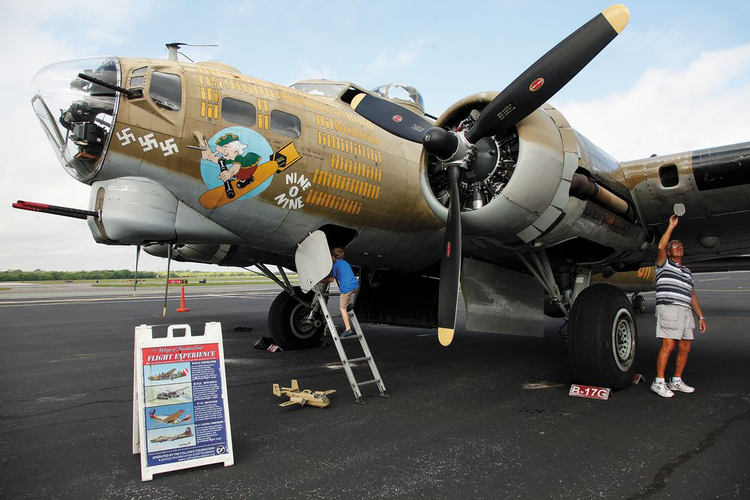 A young visitor enjoys his first look at a B-17.