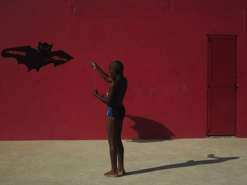 Boy playing with kite in the favela of Ramos northern zone of the city of Rio de Janeiro