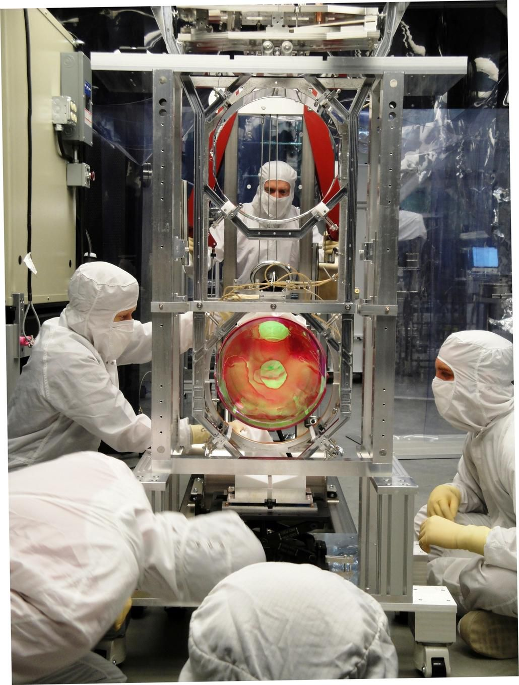 LIGO scientists working on its optics suspension.