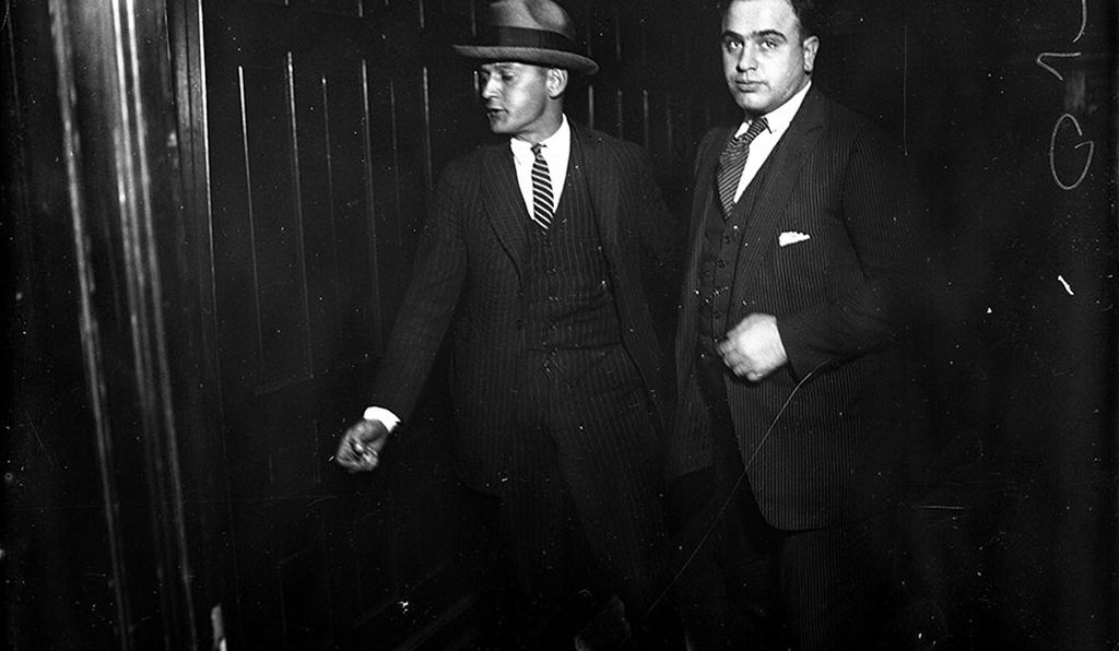 Al Capone, who went by the alias Al Brown, being led into criminal court. This photograph is undated.