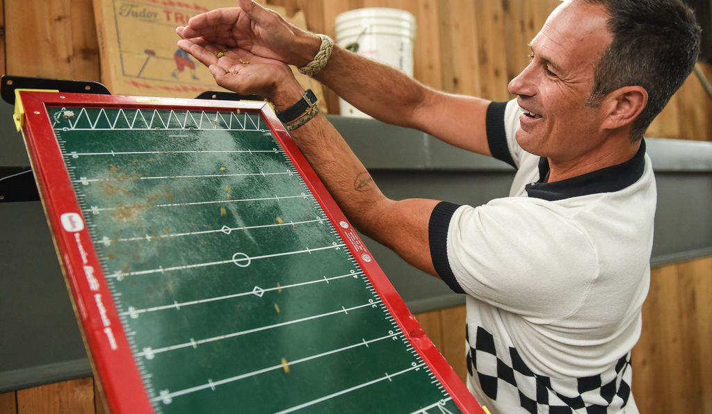 Founder and Brewer Sam Calagione, of Dogfish Head Craft Brewery, purchased this vintage vibrating football game at a thrift store, outfitted it with self-fabricated parts and angled it over his boil kettle to shake hops gently into the brew.