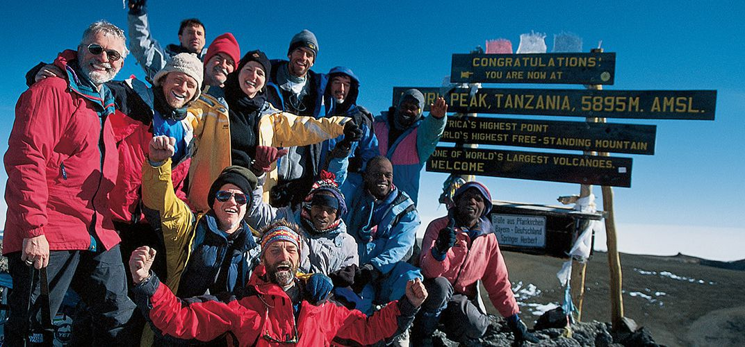 Hikers at the summit of Mt. Kilimanjaro