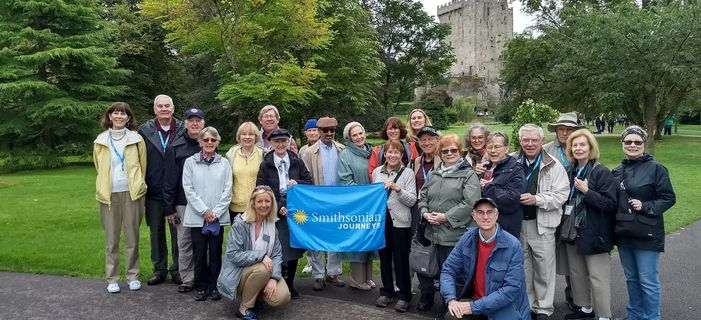 Smithsonian Journeys travelers enjoying the Emerald Isle in front of Blarney Castle