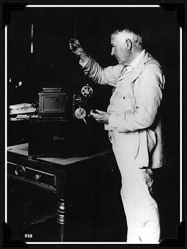 Edison examines one of his kinetoscopes in 1912