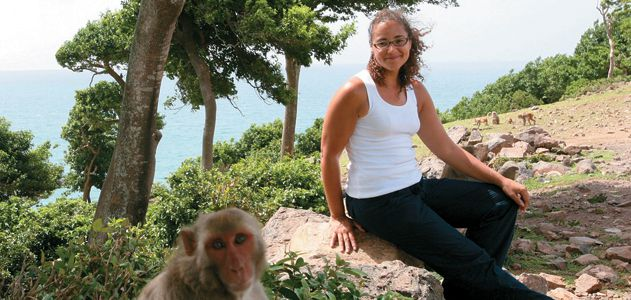 biologist Laurie Santos (with a research subject on Cayo Santiago)