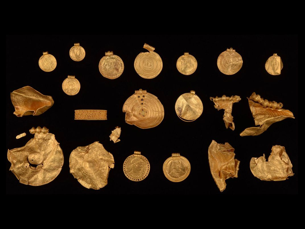 Gold objects found by amateur treasure hunter