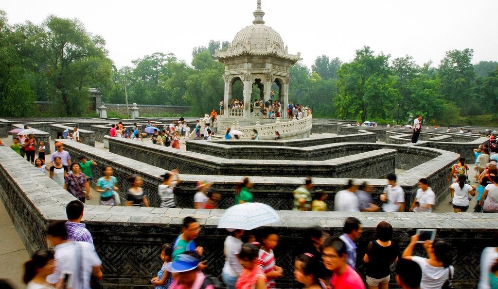 Tourists walk through a labyrinth at the old Summer Palace, also referred to as Yuanmingyuan, located in the outskirts of Beijing, China.
