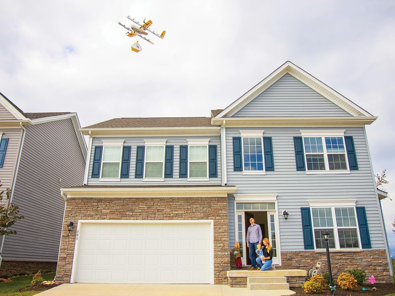 drone hovering over a house