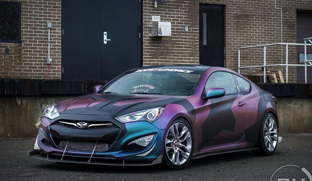 This Boston company aims to change a car's colors as quickly as a chameleon.