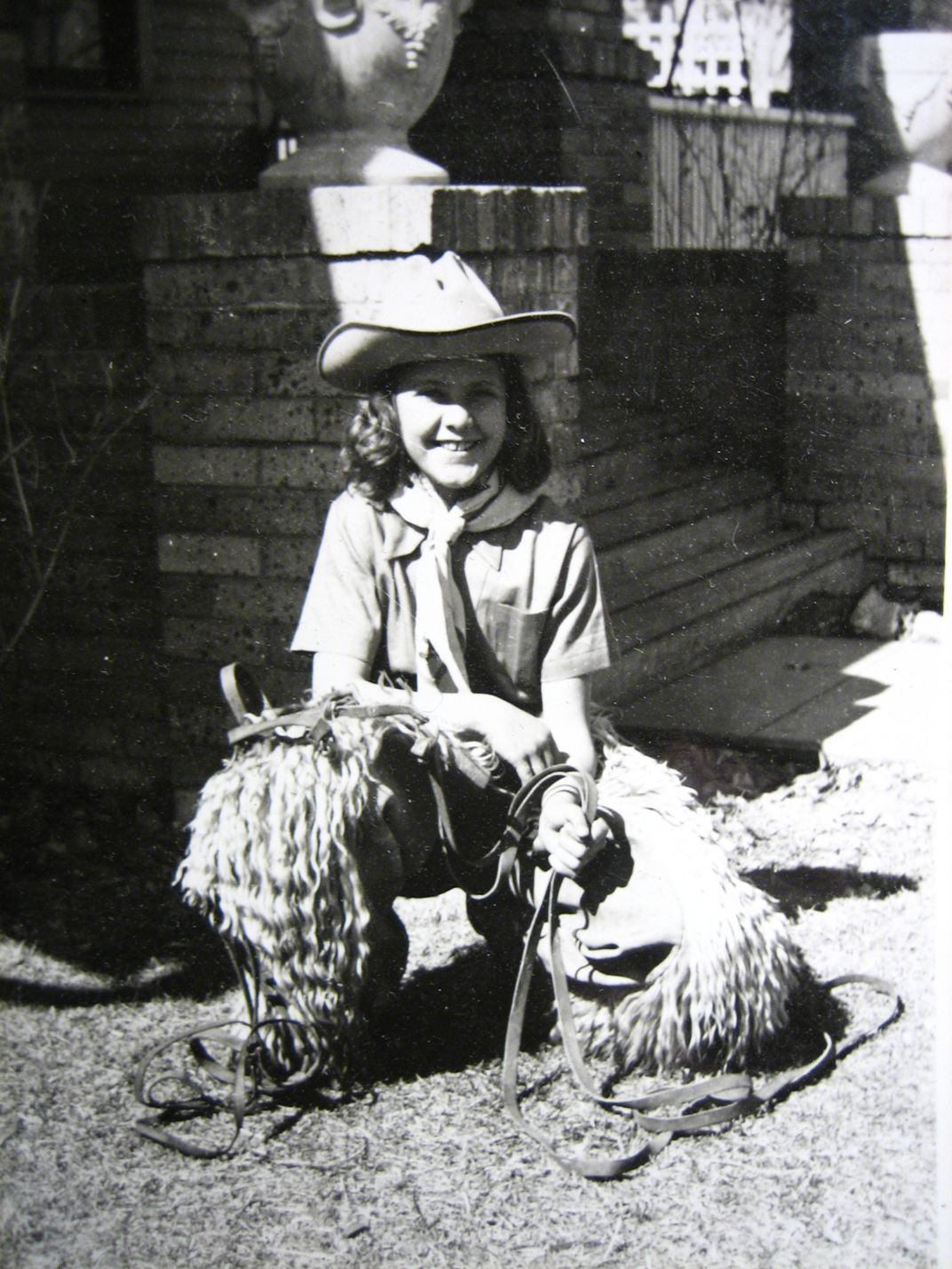 Young girl dressed as a cowgirl in black and white
