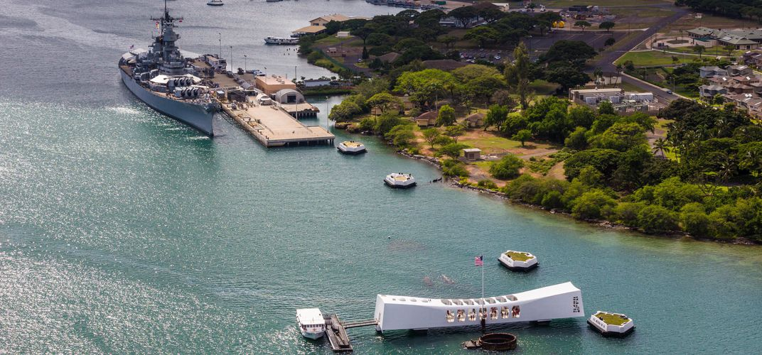 The USS <i>Arizona</i> Memorial and USS <i>Missouri</i>. Credit: Hawaii Tourism/Tor Johnson