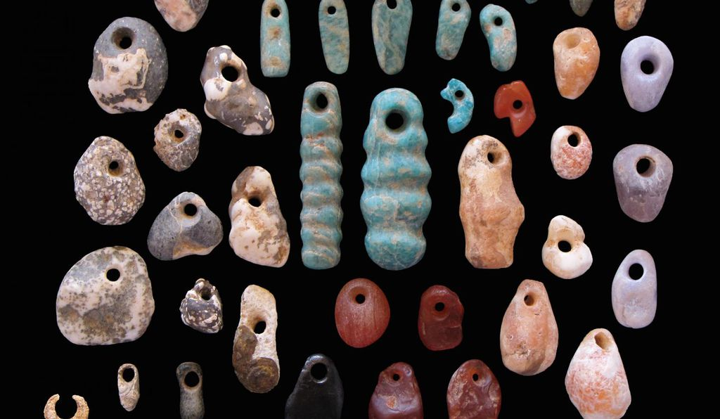 Stone pendants and earrings from the communal cemetery of Lothagam North. Most burials had highly personalized ornaments, but none seemed to distinguish one person above others.