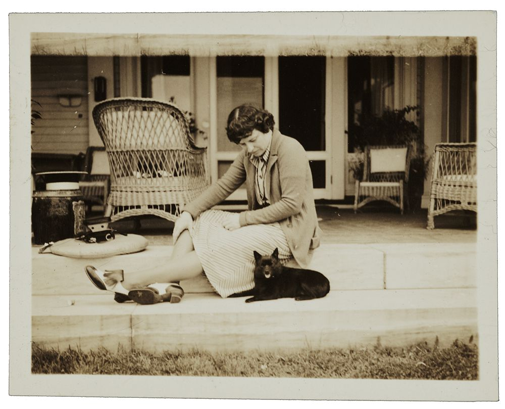 Photograph of sculptor Katherin Ward Lane Weems with a dog