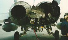 The starboard engine on the author's F/A-18D takes licking, keeps ticking after a February 21, 1991 Iraqi missile strike.