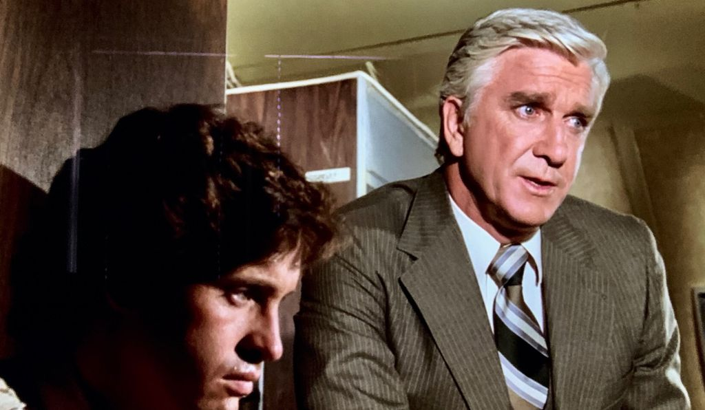 Robert Hays and Leslie Nielsen, whose career got a major shot in the arm after he played a doctor in <em>Airplane!</em>