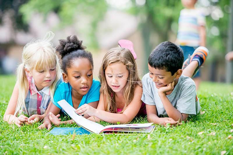 kids reading outside-main.jpg
