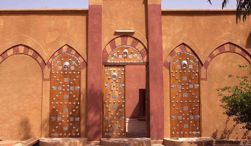 The traditional metal-studded wooden doors of Timbuktu welcome visitors at the street entrance to the Mamma Haïdara Library. Timbuktu, Mali.