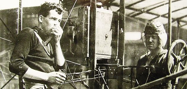 Just months after Lieutenant Paul Beck made an early airborne radio transmission, aviators test a receiving set - with the airplane's engine running - on North Island, Washington.