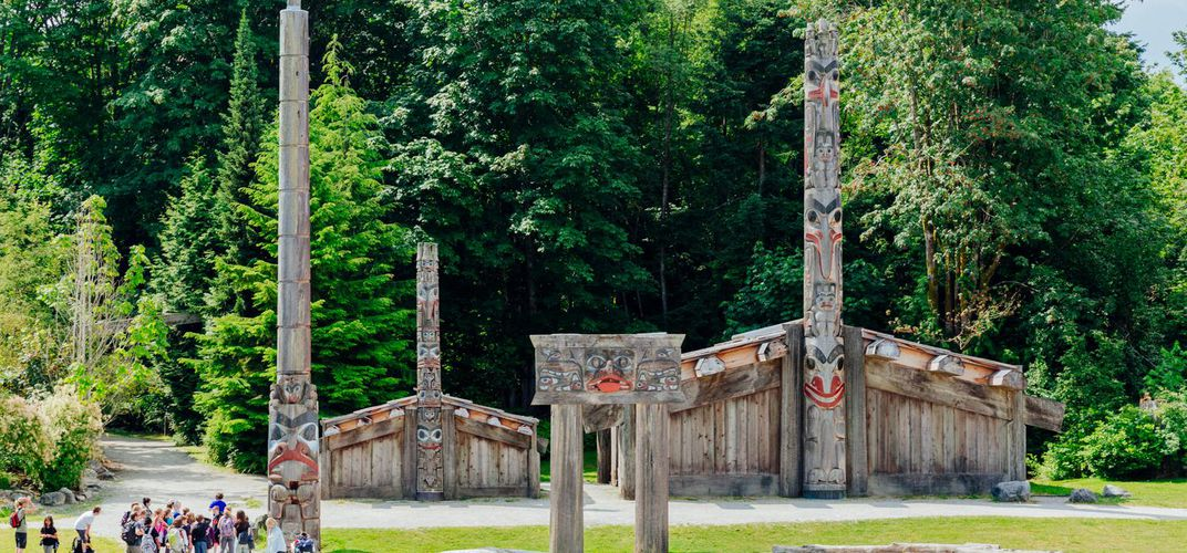 Totem poles and ceremonial house outside the Museum of Anthropology, Vancouver. Credit: Museum of Anthropology