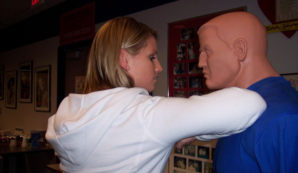 A Southwest Airlines flight attendant practices an elbow strike on a martial-arts dummy as part of the self-defense module of her annual recurrent training. The FAA requires cabin crew to recertify every 12 months.