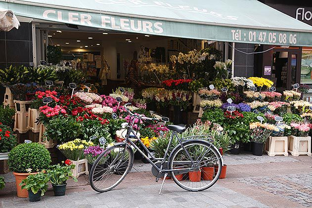 Bicycle outside flower stall Rue Cler Paris