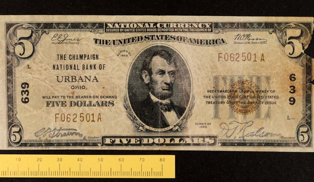 A counterfeit $5 banknote that it is believed to be created by Lustig and Watts.