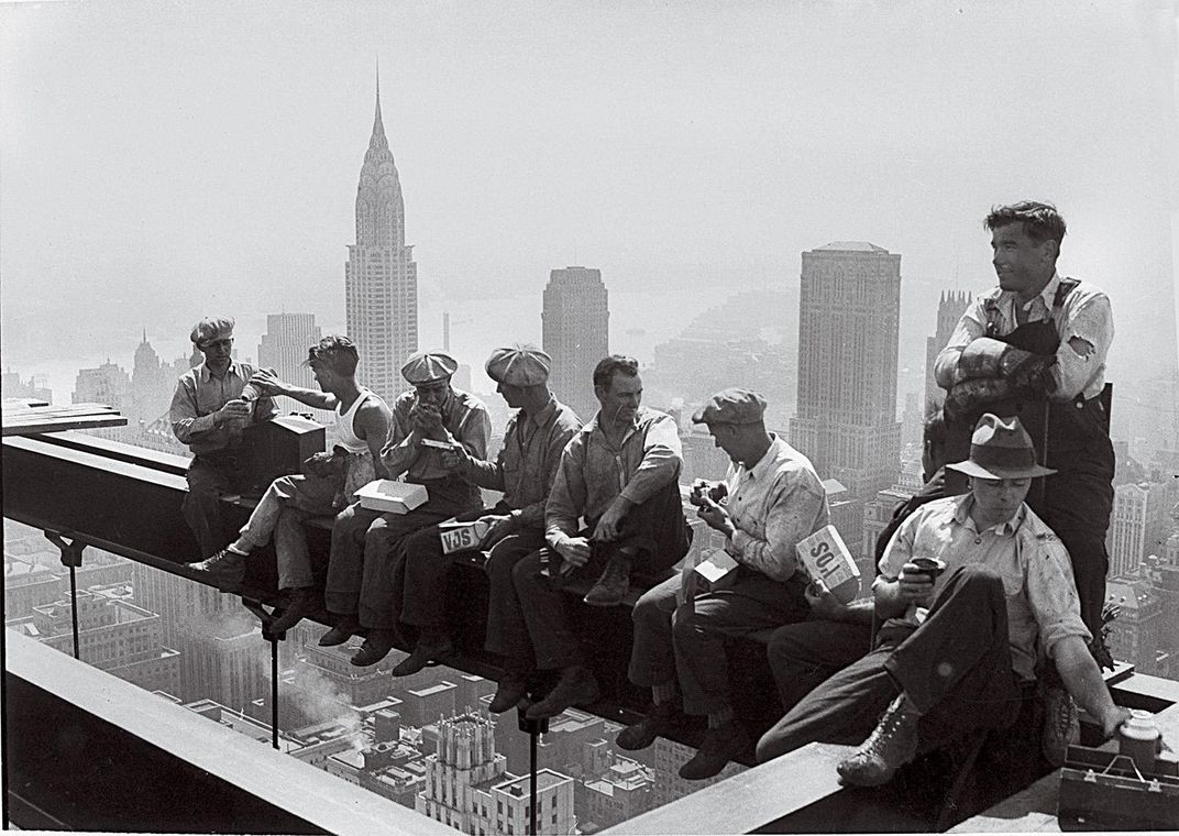 construction workers lunching on a steel beam atop the 66-story RCA Building in New York in September 1932.