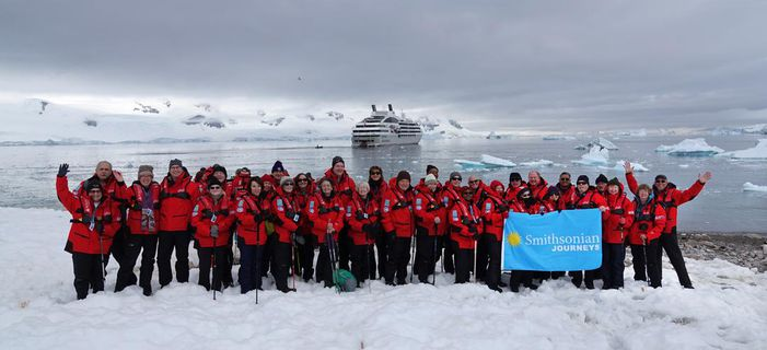 Smithsonian Journeys travelers on an Expedition to Antarctica with the Le Soléal in the background