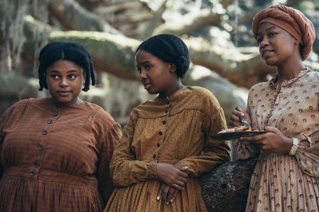 Mbedu stars as Cora (center). Zsane Jhe, left, and Aubriana Davis, right, portray other women enslaved on the Randall plantation.
