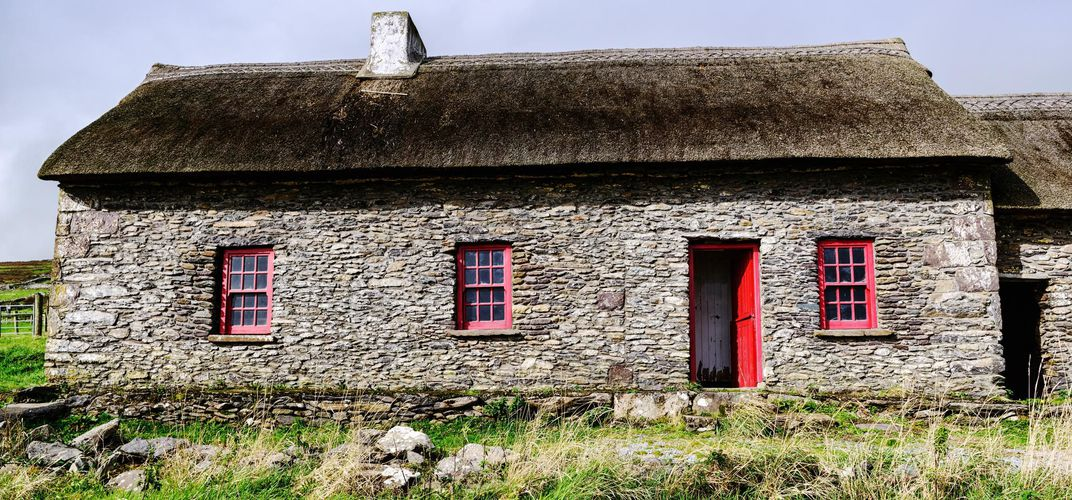 Traditional thatched stone cottage