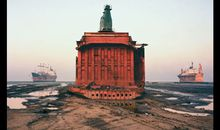 The carcass of a cargo ship, already sheared of its forward structure, sits where it was parked on the beach at Chittagong, Bangladesh
