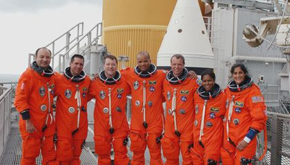 The crew of STS-116 prepares for their December 7 space shuttle launch.