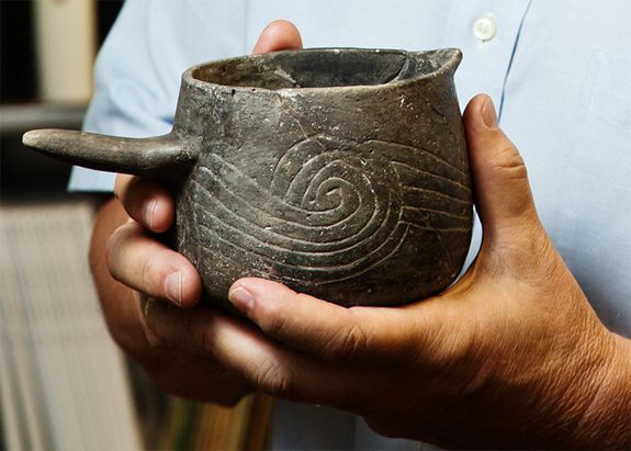 "Pottery beakers were used to hold the ""Black Drink""."