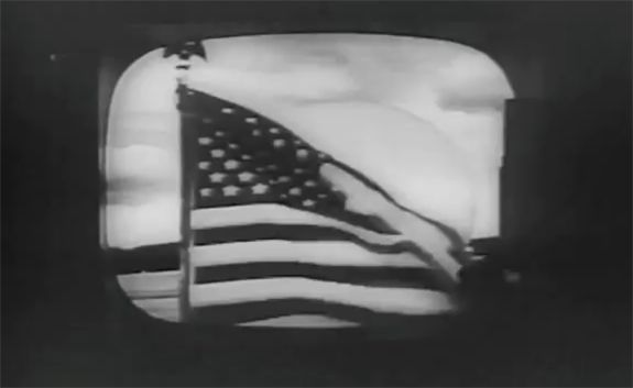 An American flag waving in Andover, Maine. This was the first video ever transmitted by commercial satellite.