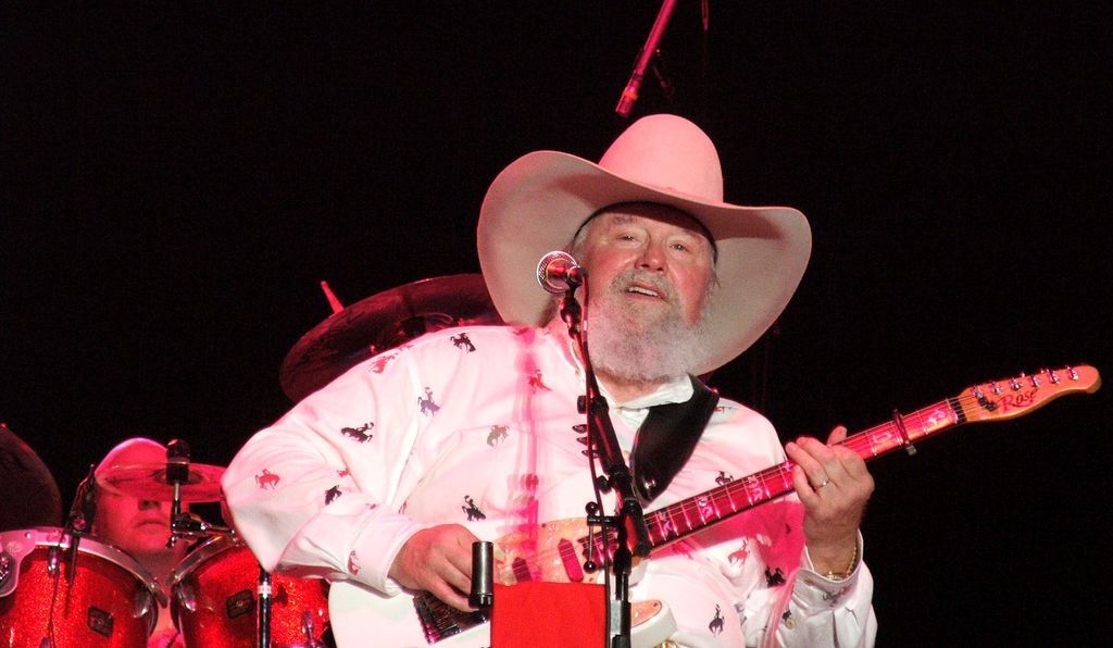 Charlie Daniels performs at a concert.