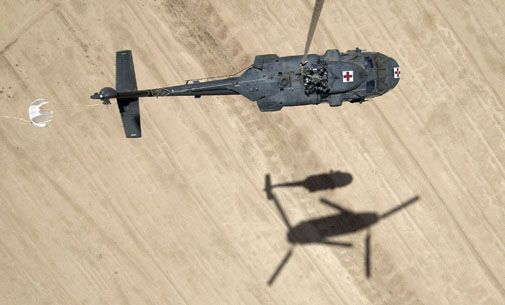 One helicopter helps another in Iraq.
