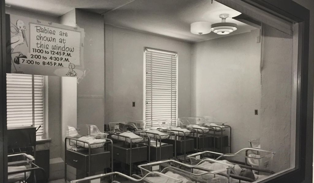 Photo of the Admitting Nursery at a Houston-area hospital with listed times for baby showings in approximately 1960.
