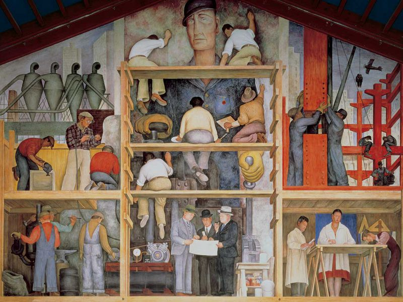 A large mural that contains scaffolding separating many levels, with workers in overalls and industry prominently featured; a white worker in a blue cap looms larger-than-life in the background over the busy scene