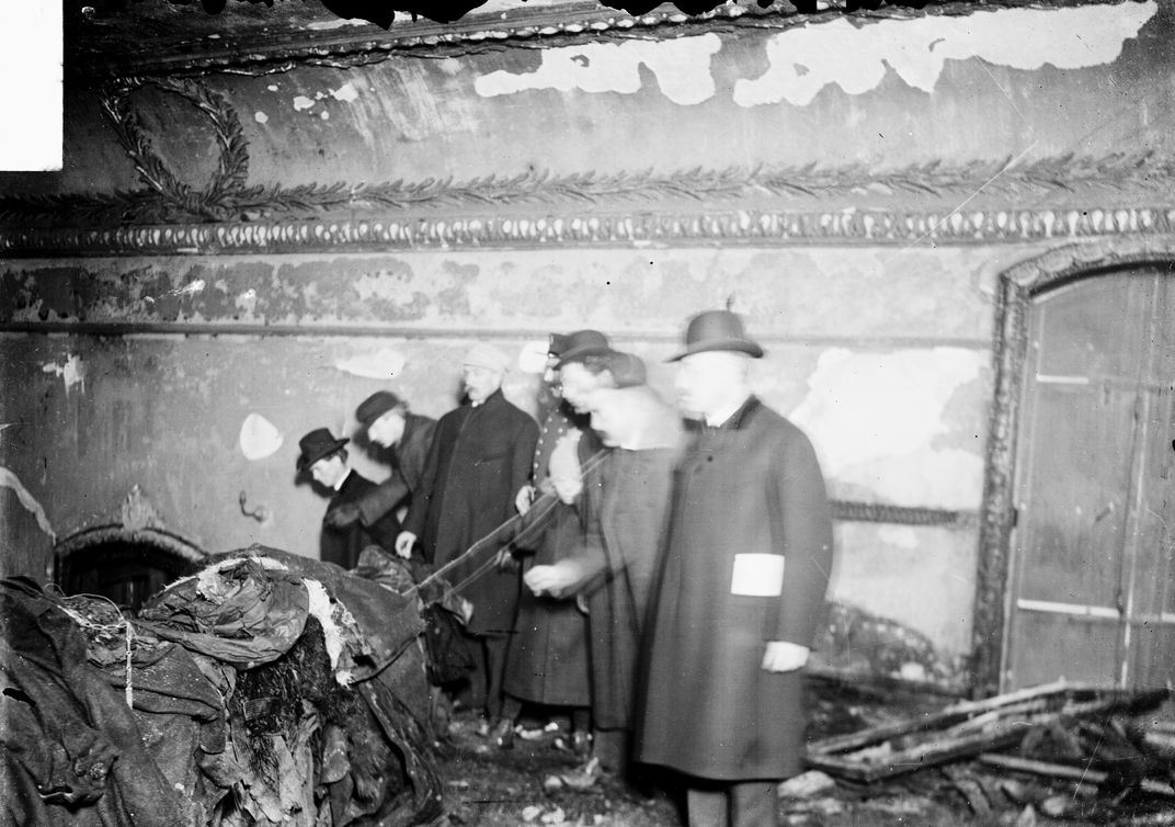 Group standing inside the Iroquois Theater