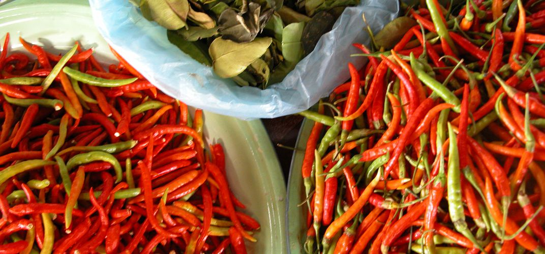 Chillis and kaffir lime leaves, essential ingredients in Thai cuisine